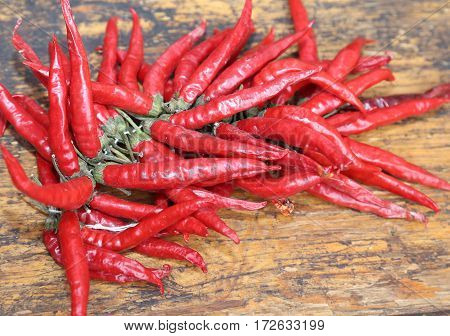 Red Hot Peppers On Wooden Table At  Market