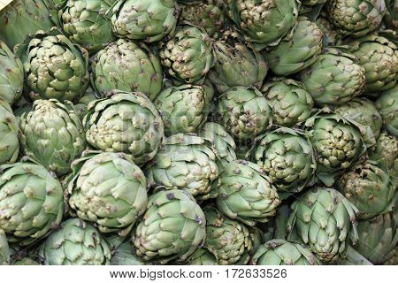 Green Background Of Artichokes For Sale