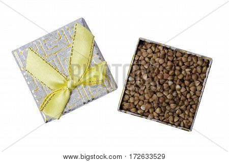 Buckwheat in a box with a yellow bow macro isolation