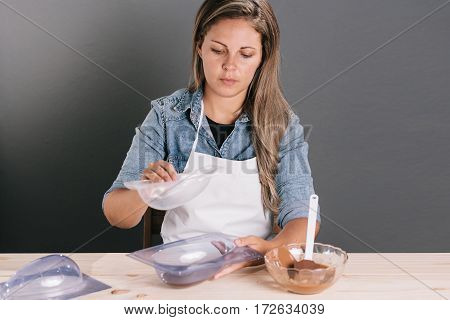 Young Brazilian Woman Making Homemade Easter Eggs