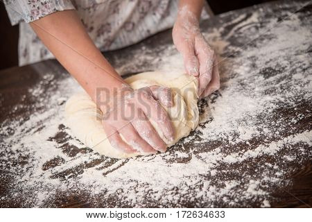 Knead dough with hands , making homemade bread