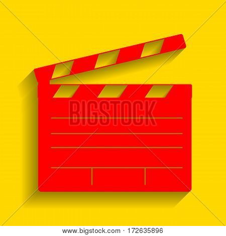 Film clap board cinema sign. Vector. Red icon with soft shadow on golden background.