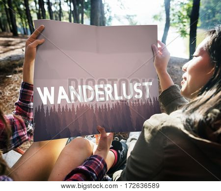 Wanderlust word on nature background with trees