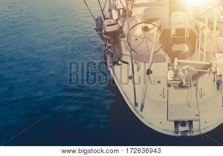 Open Sea Yachting Time Boating Photo Concept. Yacht on the Blue Water Closeup Photo.