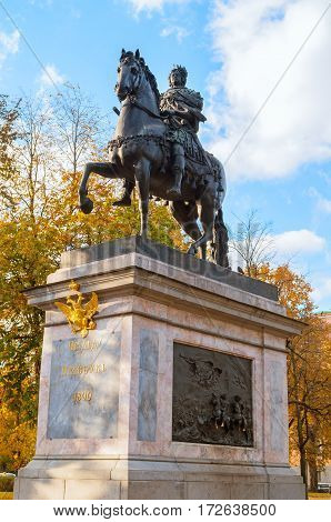 ST PETERSBURG RUSSIA-OCTOBER 3 2016. The Monument to Peter I bronze equestrian monument of Peter the Great in front of the St. Michael's Castle in St Petersburg Russia. St Petersburg Russia city landscape