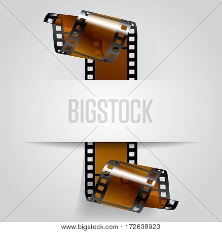 Paper banner with a brown curled film strip. Movies concept