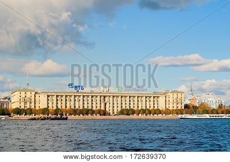 ST PETERSBURG RUSSIA - OCTOBER 3 2016. Petrovsky embankment - residential house for employees of People's Commissariat of the USSR Navy. On the roof - logos of VTB bank and Megafon company.