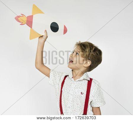 Boy Holding Spaceship Rocket Icon