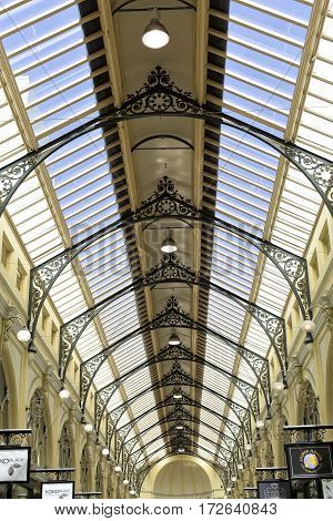 MELBOURNE, AUSTRALIA - January 12, 2017: The Royal Arcade features a high glass roof and rows of arched windows to the storerooms above each shop.
