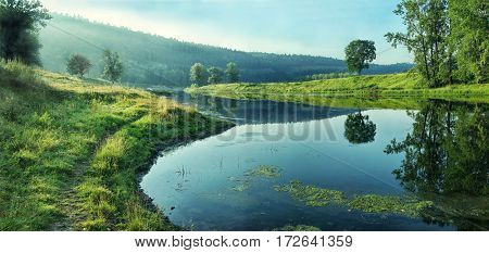 Quiet Backwater Of River On The Background Of Forest Slope.