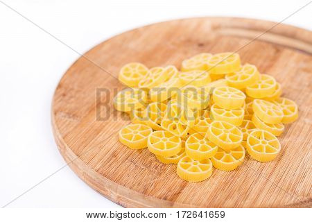Raw Unboiled Pasta On The Kitchen Cutting Board