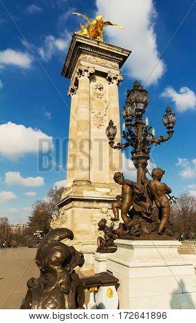 Bronze lamps on Alexander III Bridge Paris France
