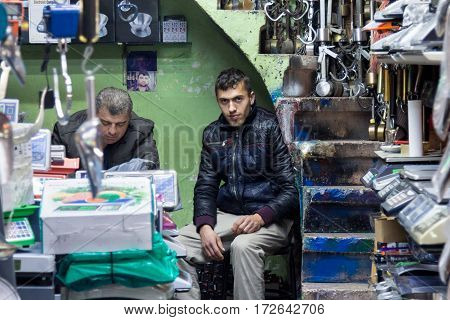 ISTANBUL TURKEY - DECEMBER 29 2015: Shopkeeper selling scaling devices in a shop on the European side of the city