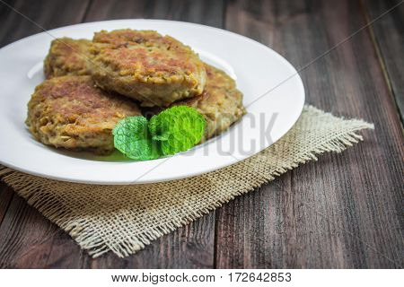 Cutlets In Plate On A Wooden Background
