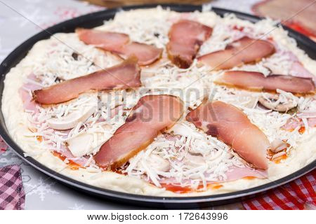 Raw Prepared Pizza With Domestic Sirloin And Sausages