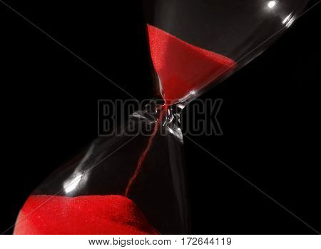Hourglass on black background