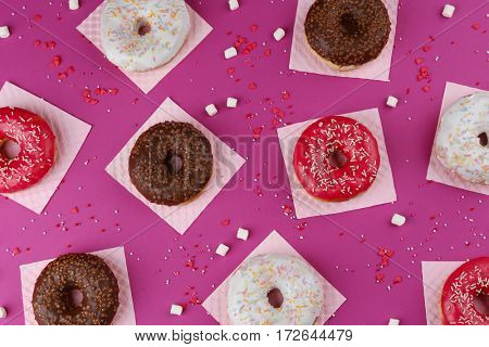 Glazed donuts on color background