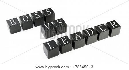 Lines of black cubes with text BOSS VS LEADER isolated on white