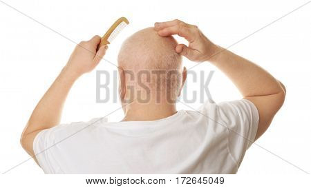 Bald senior man with comb on white background