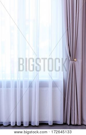 Room window with white and grey curtains
