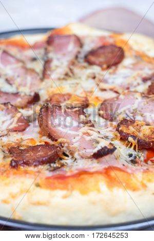 Flat Lay Overview Of Pizza With Domestic Ham Sirloin And Sausage