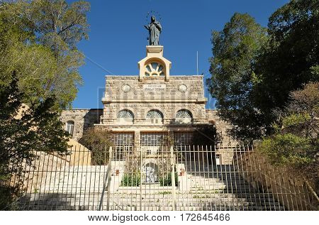 Statue of Virgin Mary on the front of the monastery of Deir Rafat also known as the Shrine of Our Lady Queen of Palestine and of the Holy Land