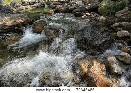 Water Of Mountain River Flows Down From The Rocks