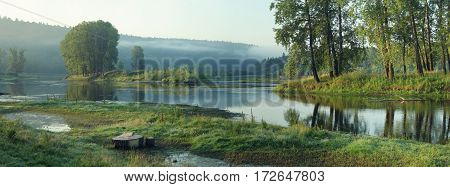 Backwater With Islands With Trees In Summer