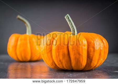 Orange Decorative Pumpkins On A Gray Background