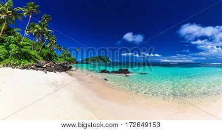 Panorama of vibrant tropical Lalomanu beach on Samoa Island with coconut palm trees