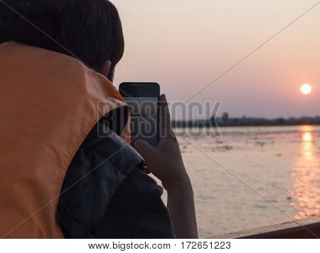 Man taking picture by himself, travel concept
