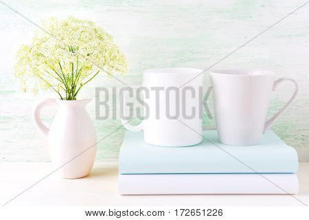 White coffee and latte mugs mockup with wild flowers. Empty mug mock up for design presentation.