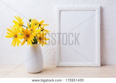 White frame mockup with yellow rosinweed flowers in pitcher. Empty frame mock up for presentation artwork.