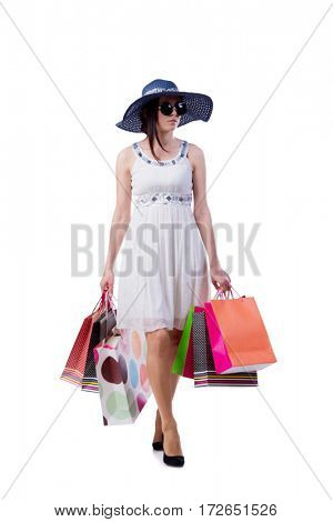Young woman with christmas shopping bags on white