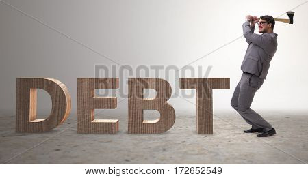 Angry man with axe axing the word debt