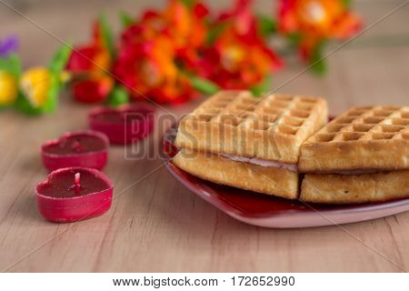 Wafers On A Plate On A Wooden Background