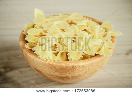 Dried Italian Bowtie Pasta Or Farfalle On A Wooden Background