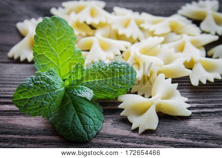 Pasta With Mint On Wooden Background