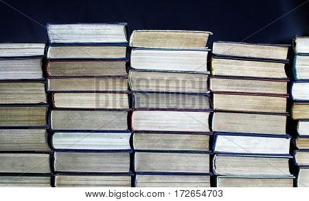 Big Pile Of Books On Dark Background