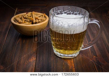 Beer With Croutons On Wooden Background
