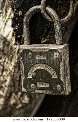 Old Padlock Hanging On The Rotting Jamb