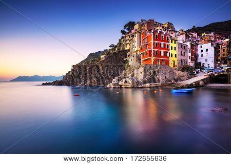 Riomaggiore town cape and sea landscape at sunset. Seascape in Cinque Terre National Park Liguria Italy Europe. Long Exposure