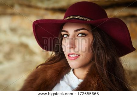 portrait of a beautiful girl in the hat on a mountain background