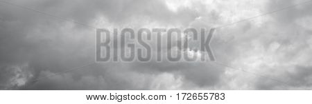 Panorama of a gray cloudy sky. Thunderclouds over horizon cloudscape storm.