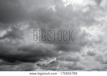 Gray cloudy sky. Thunderclouds over horizon cloudscape storm.
