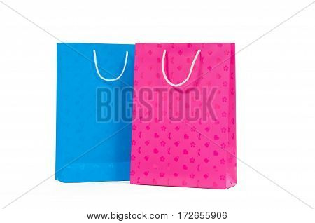 Pink and blue paper bag isolated on white background