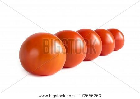 Red Cherry Tomatoes In A Row On A White Background. Isolate.