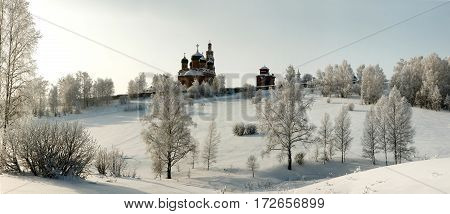 Bare Hoary Trees With Orthodox Church Afar On The Slope