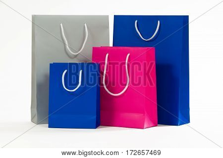 Multicolored paper shopping bag isolated on white.