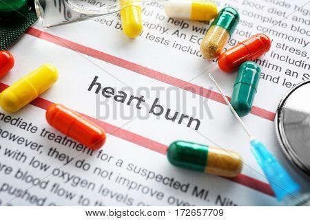 Phrase HEART BURN in center of medicines